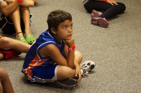 Attentive camper listens to Mr. Dilly