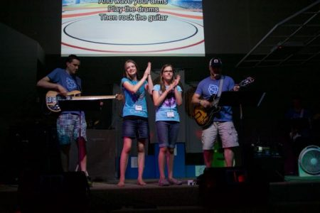Two campers help lead a new song!